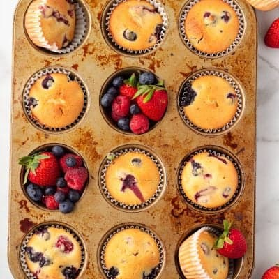 overheaad shot of Triple Berry Muffins in a muffin tin