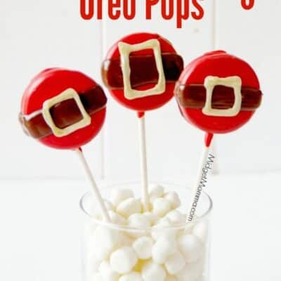 Christmas Oreo Pops decorated to look like Santa's belly. Oreo cookies dipped in chocolate decorated for Christmas to make these super cute Christmas Oreo Pops.