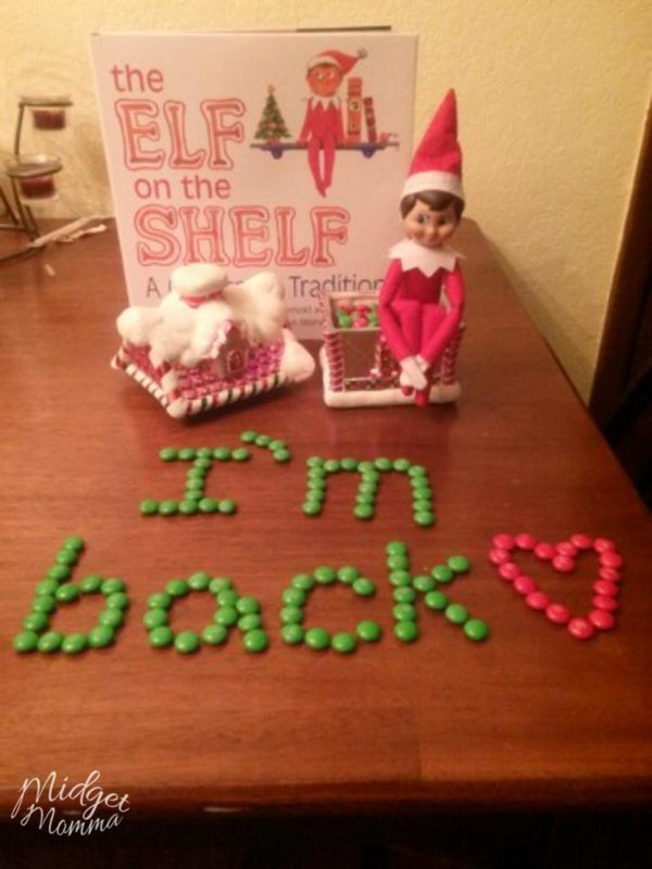 """Easy Elf on the Shelf Ideas- Elf on the shelf I'm Back Idea - Spelling out """"I'm Back"""" with candy on the table"""