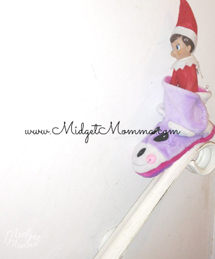 Easy Elf on the Shelf Ideas- elf in a slipper sliding down a banister