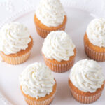 vanilla cupcakes on a white platter