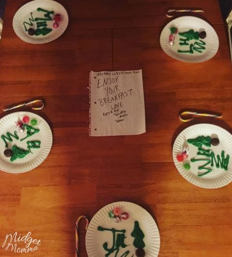 Elf on the Shelf Brings Breakfast idea. Hand drawn chocolates and candycanes on white plates with a note from the elf on the shelf. Easy Elf on the shelf Ideas