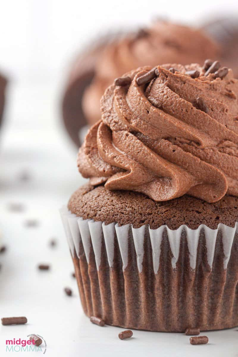 close up photo of chocolate cupcake with chocolate buttercream frosting and chocolate sprinkles