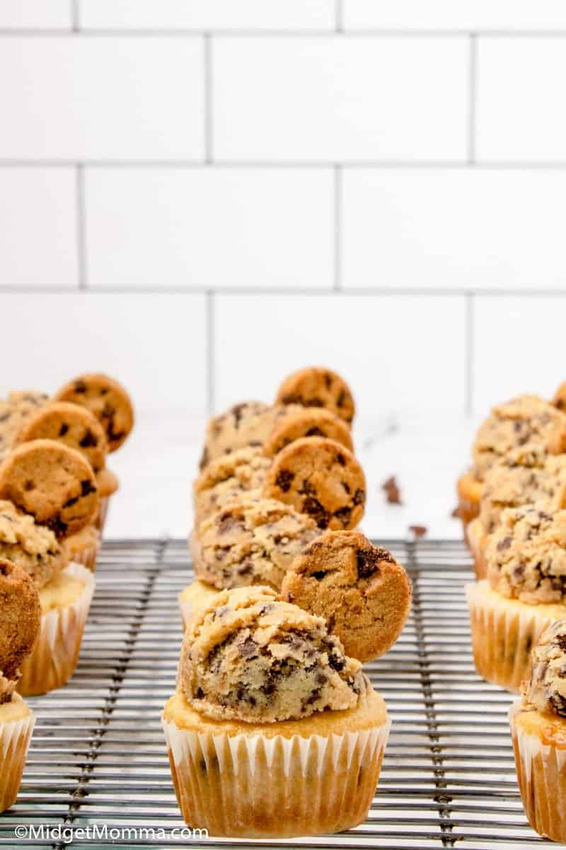Front photo of Chocolate Chip Cupcakes frosted with chocolate chip cookie dough frosting on a baking rack