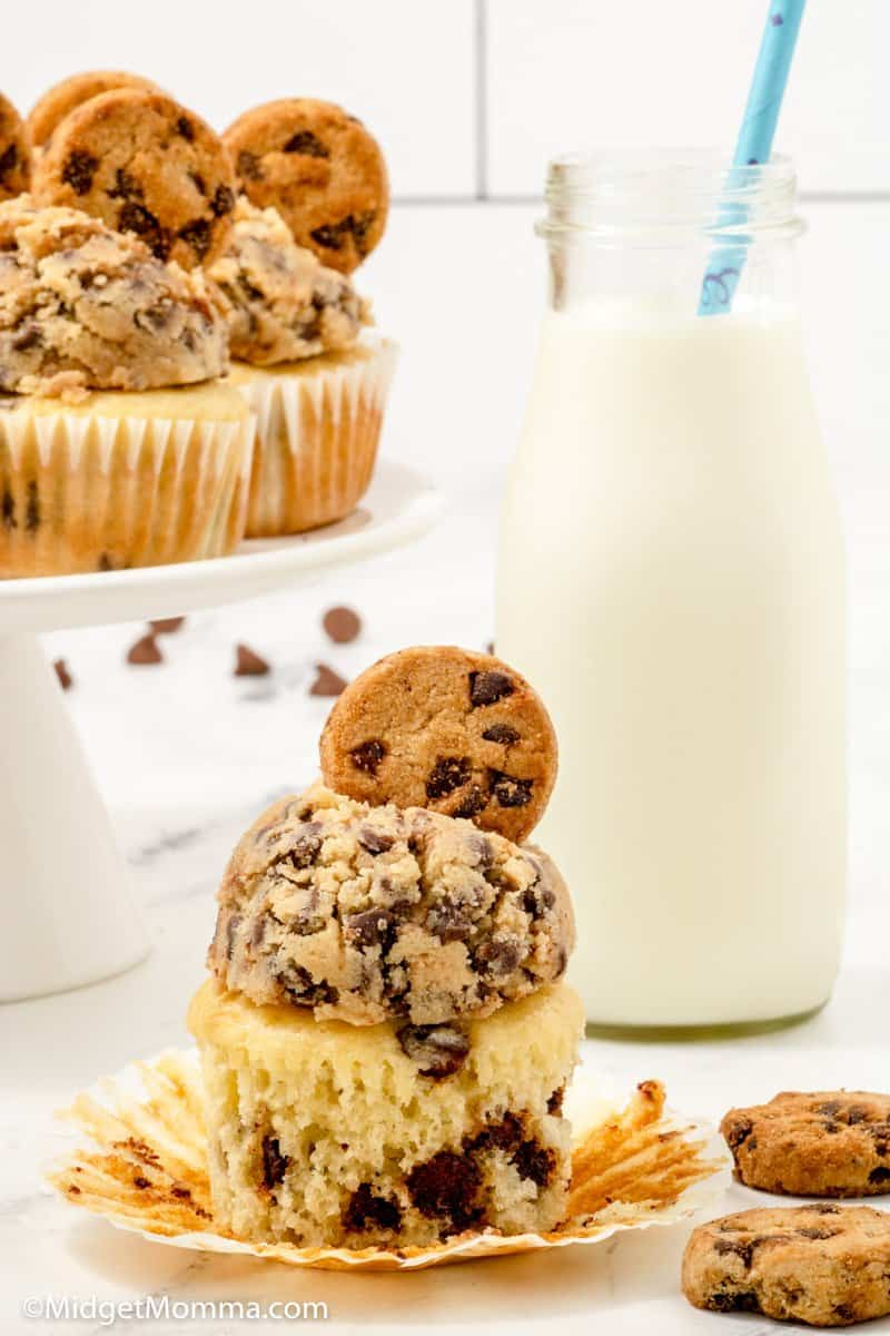 Chocolate Chip Cupcakes with the wrapper pulled off and a glass of milk