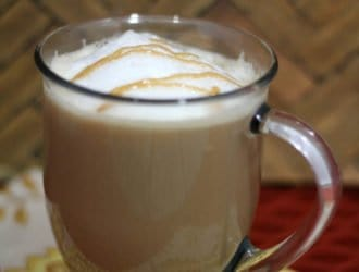Caramel Macchiato Starbucks copycat recipe in a cup on the kitchen counter