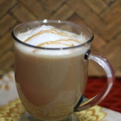 Caramel Macchiato Starbucks copycat recipe in a cup on the kitchen counter