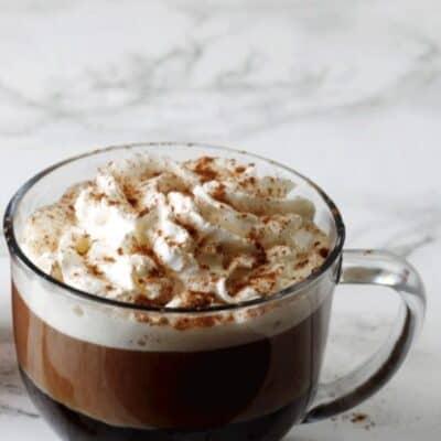 Starbucks pumpkin spice latte Copycat recipe in a glass coffee cup
