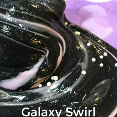 This Galaxy Swirls slime Recipe is made with no borax homemade slime. A mix of black slime and pink slime with fun slime add ins this easy slime recipe is one the kids will love. #slime #blackslime #pinkslime #HomemadeSlime #GalaxySlime #NoBoraxSlime #EasySlime