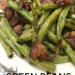 Made in a foil packet, Green Beans with Bacon is made with fresh green beans and filled with buttery garlic bacon flavors and cooked right on the grill! #GreenBeans #Grilled #Garlic #Bacon #FoilPacket #grillRecipe #GreenBeanswithBacon