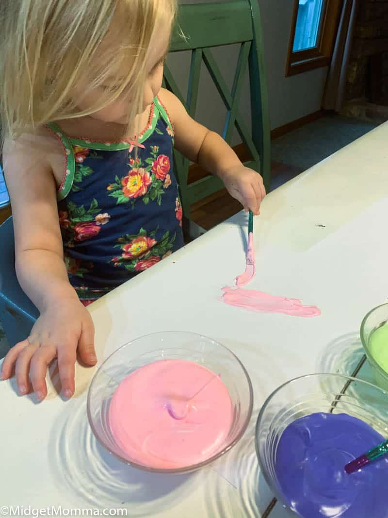 Toddler painting with homemade puffy paint
