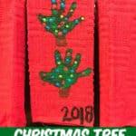 handprint Christmas Tree towel hanging on the stove door in the kitchen