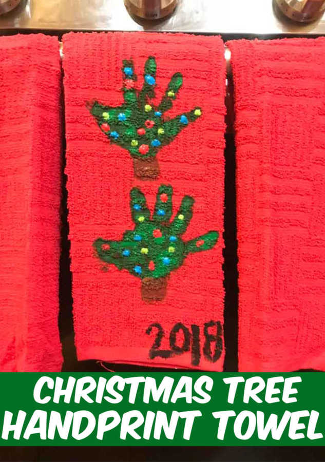 handprint Christmas Tree towel hanging on the stove door in the kitchen