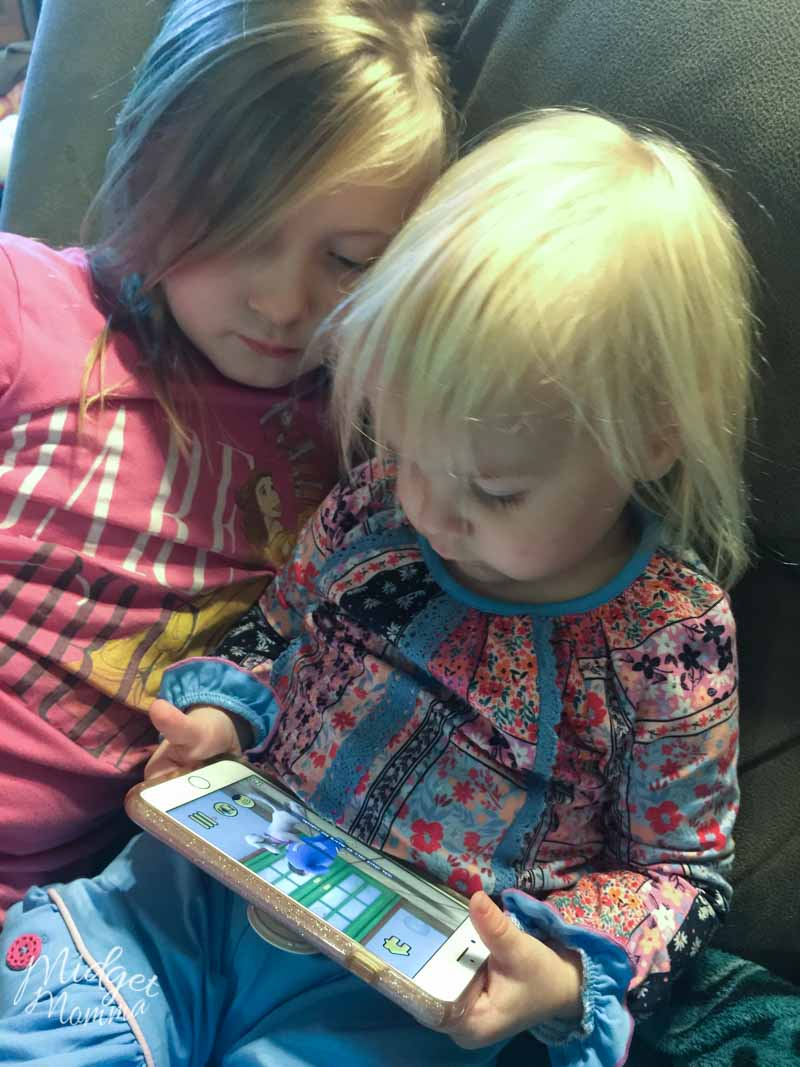two kids reading Maxi the Taxi Dog Interactive Reading App for kids