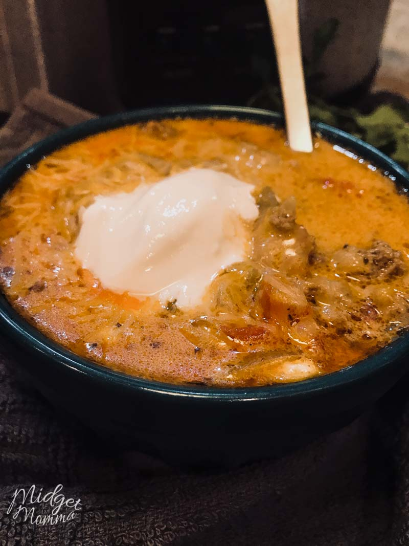 Low Carb taco soup in a blue bowl with a spoon