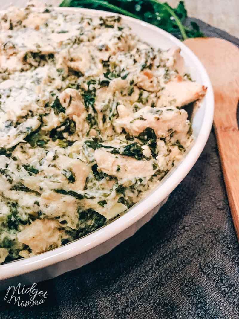 Casserole dish of spinach artichoke chicken casserole