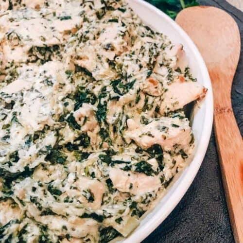 Casserole dish filled with spinach artichoke chicken casserole
