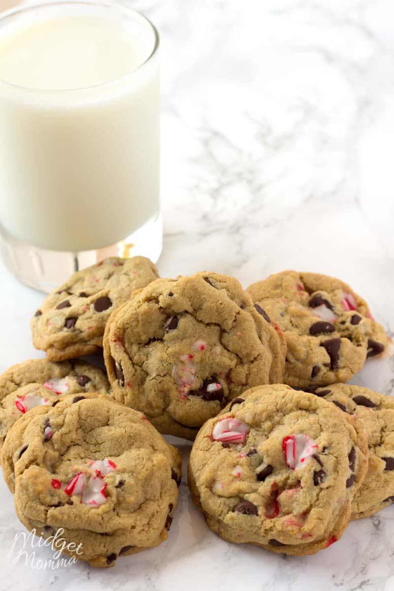 Peppermint Chocolate chip cookies in a pile with a glass of cold milk.