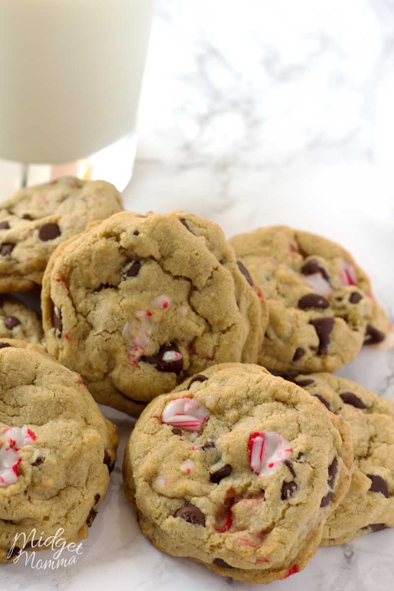 Soft Peppermint Chocolate Chip Cookies in a heaping pile, made with peppermint chips and chocolate chips along with a cold glass of milk.