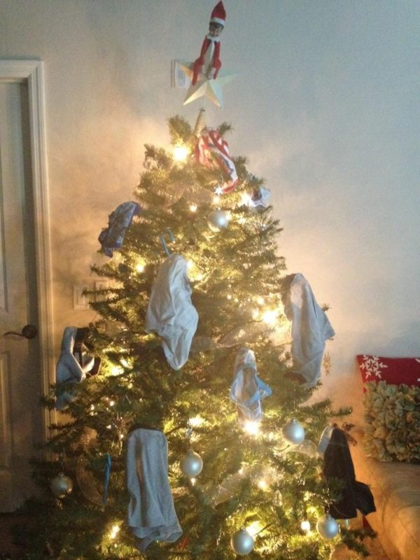 elf on the shelf ideas for toddlers - elf hangs underwear on the tree