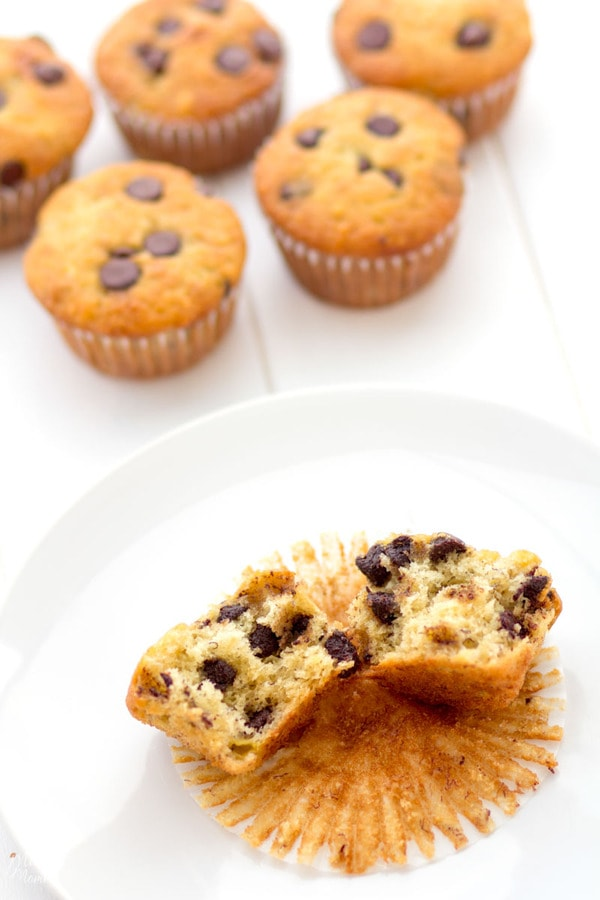 The perfect combination of banana and chocolate in these fluffy muffins sitting on the counter.