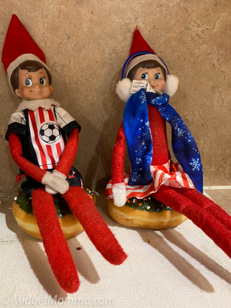 elf on the shelf tubing with a donut