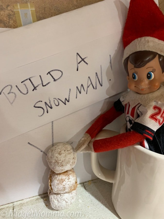 build-a-snowman elf on the shelf idea with dunkin donuts munchkins
