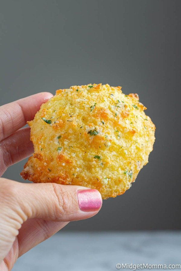 Keto Cheddar biscuit being held with a hand
