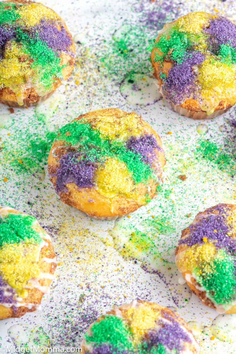 Cinnamon muffins topped with sugar icing and colored sugar