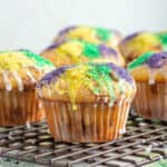 Cinnamon Muffins with icing and colored sugar recipe cooling on a baking rack