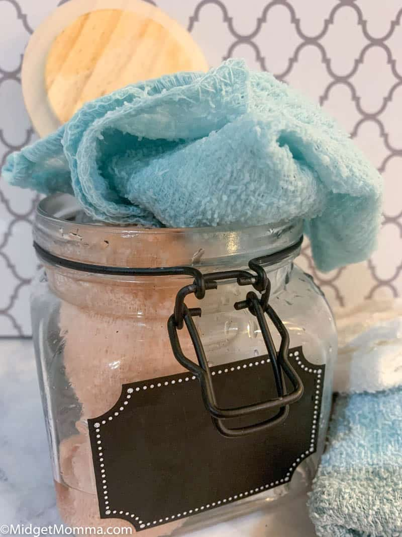 Homemade disinfecting wipes in a glass jar