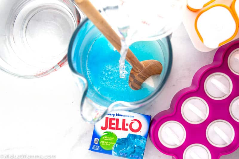 water being added to sugar, salt and Jell-o mix to make homemade pedialyte