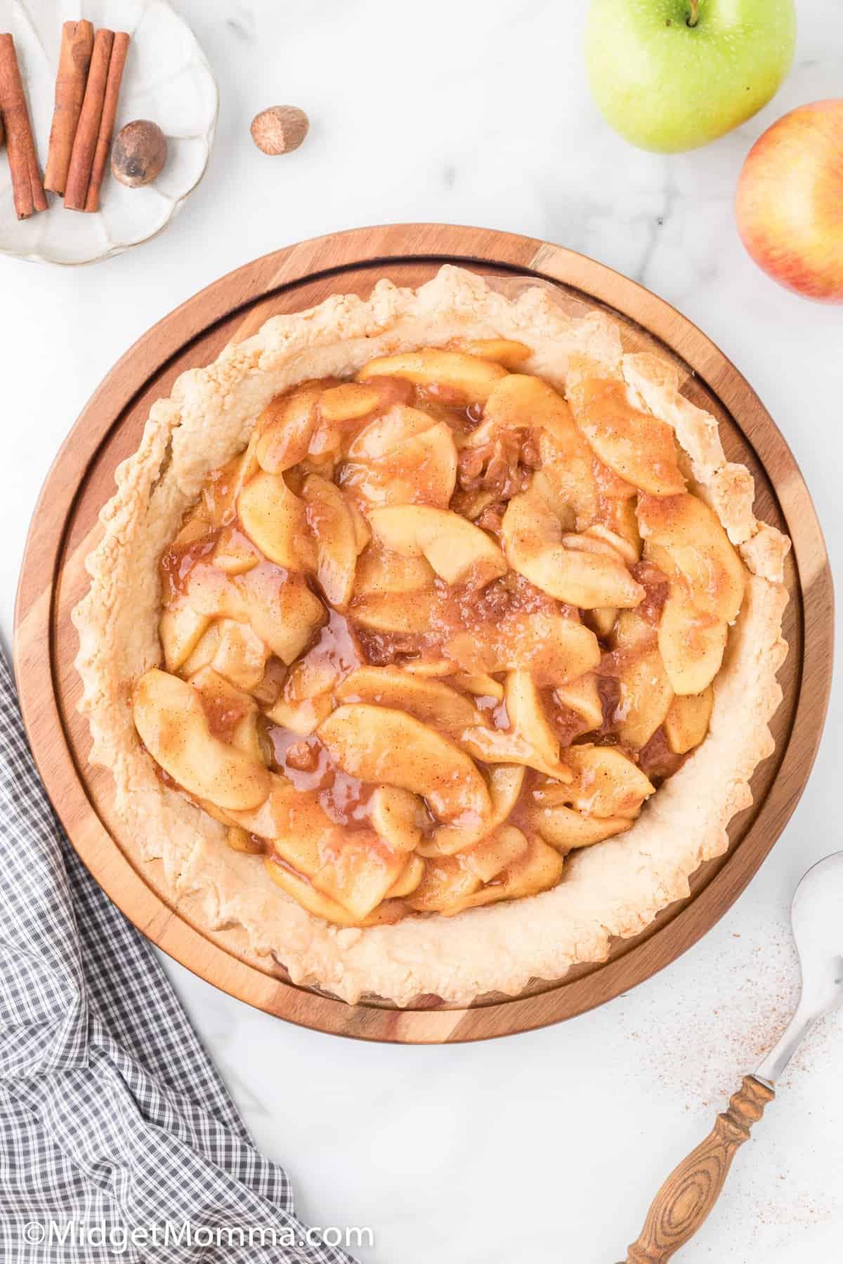homemade apple pie filling in a pie crust