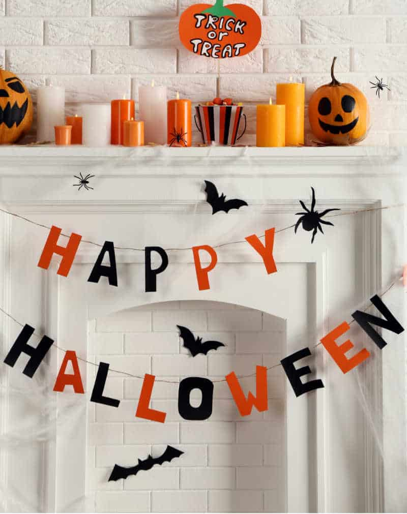 HALLOWEEN PARTY ON A BUDGET- Halloween decorations on white fireplace