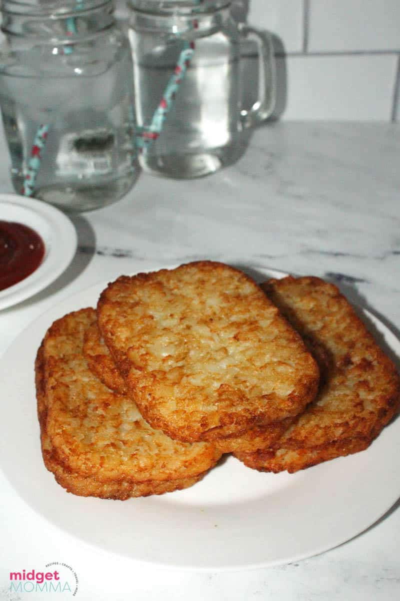 cooked hash browns in air fryer on a plate