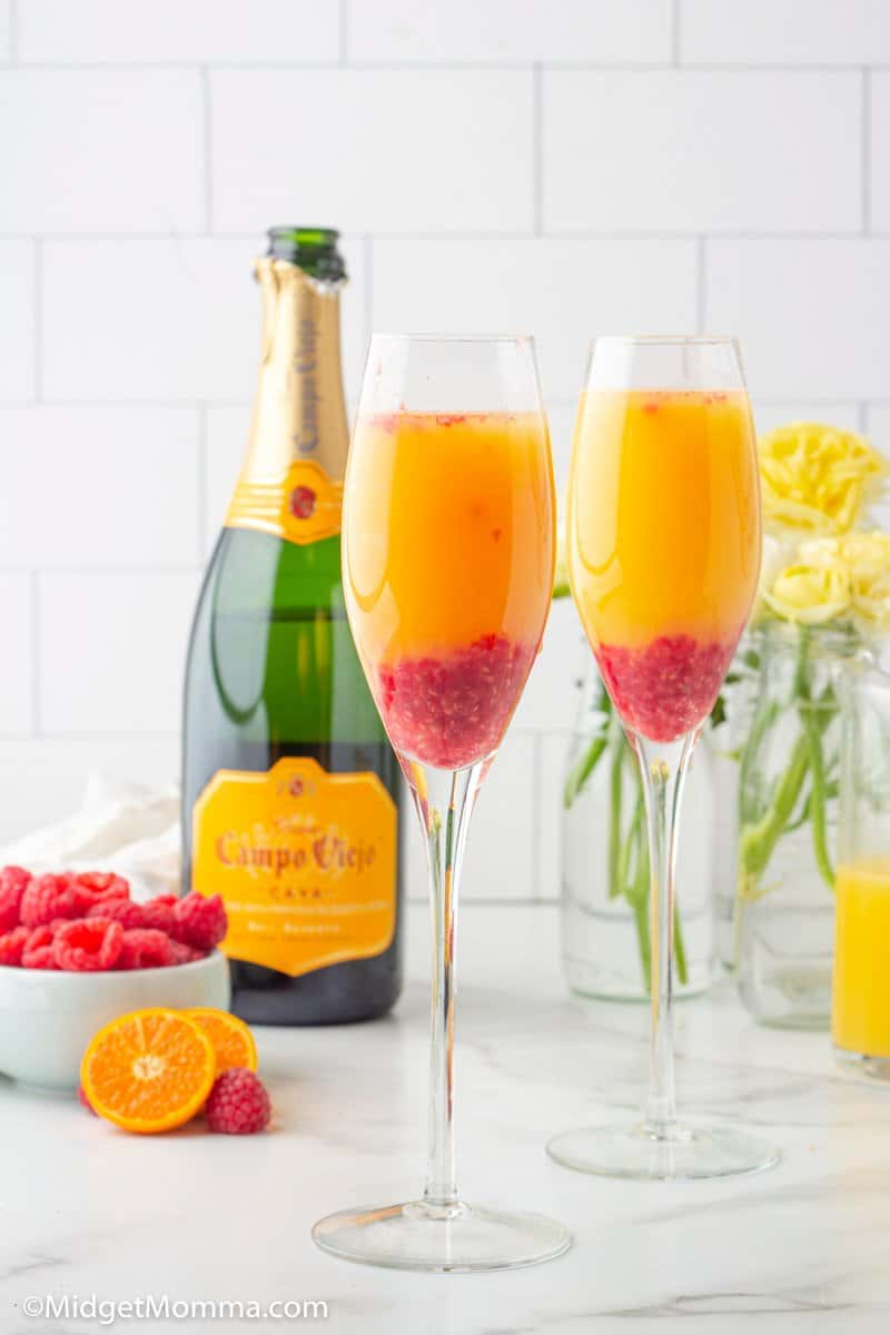Raspberry Mimosa Drink in a champagne flute