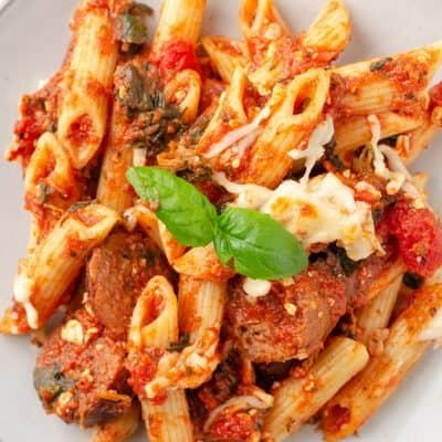 close up photo of baked penne pasta on a plate