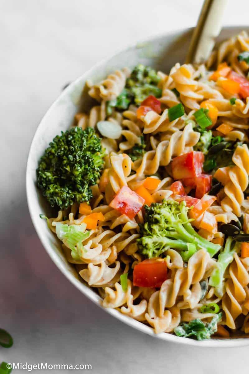 Close up photo of Tahini Pasta Salad in a bowl.