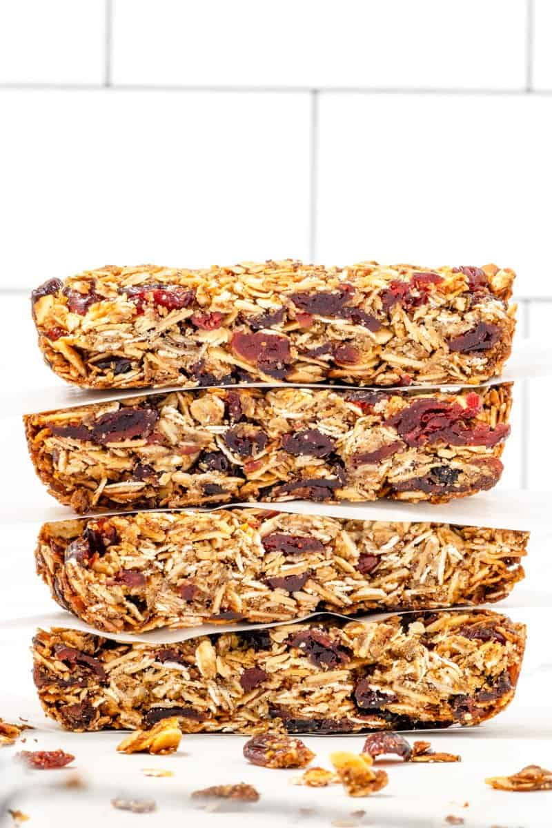 cranberry granola bars stacked in a pile
