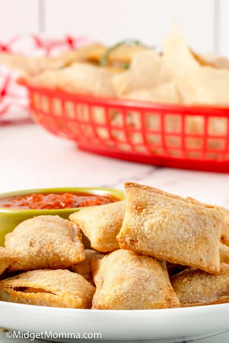 pizza rolls cooked in the air fryer on a plate