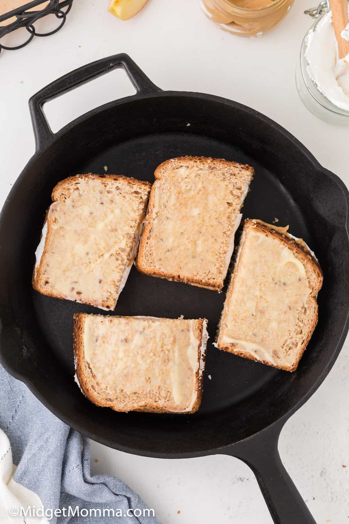 Grilled Peanut Butter and Marshmallow Fluff Sandwich in a pan cooking